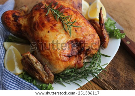 Roasted chicken with herbs - stock photo