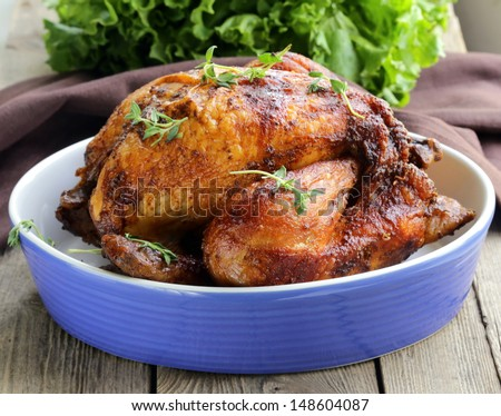 roasted chicken with herbs (thyme and sage) - stock photo