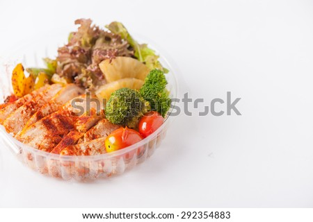 Roasted chicken with paprika powder cooked by clean food concept and salad in lunch box - stock photo