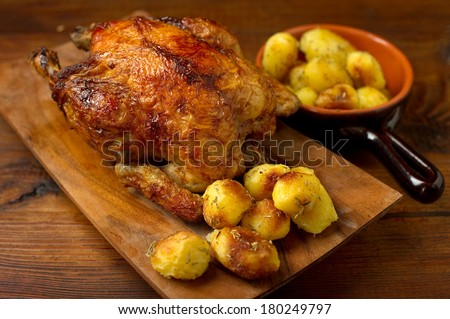 roasted chicken with potatoes - stock photo