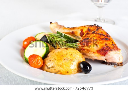 Roasted chicken with vegetables - stock photo