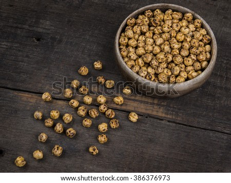 roasted chickpeas on wooden table - stock photo