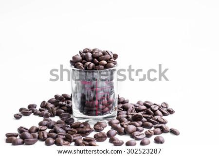 Roasted coffee bean in coffee shot glass - stock photo