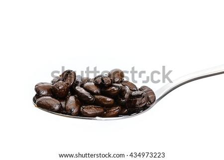Roasted Coffee Beans background texture. Arabic roasting coffee - ingredient of hot beverage. Brown coffee beans for background and texture. - stock photo