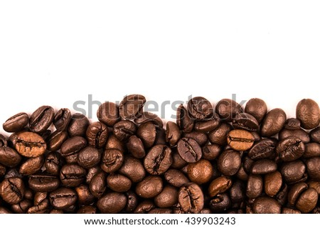 Roasted Coffee Beans background texture isolated on white background with copy space for text, - stock photo