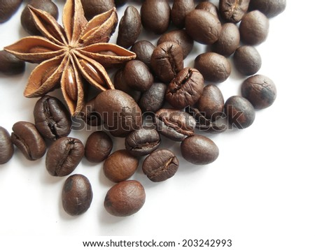Roasted coffee beans , cinnamon  and star anise. - stock photo
