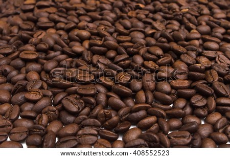 Roasted coffee beans. Close-up of coffee beans for background and texture. - stock photo