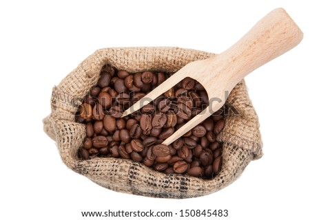 Roasted coffee beans in burlap bag top view isolated on white background. Traditional coffee background. - stock photo