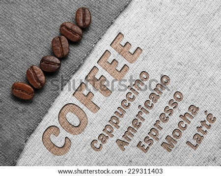 Roasted Coffee Beans on fabric textile - stock photo