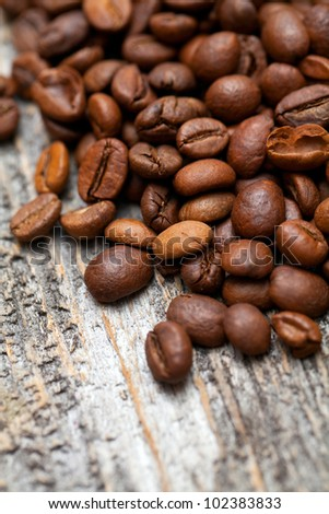 roasted coffee beans on wooden table - stock photo