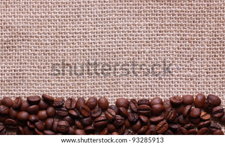 Roasted coffee menu beans on linen sackcloth - stock photo
