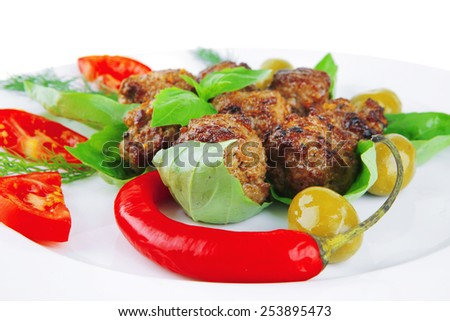 roasted cutlets served on basil with vegetables - stock photo