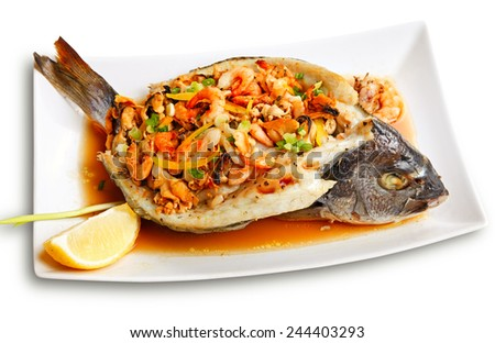 Roasted dorade stuffed with seafood isolated on white background by clipping path. - stock photo