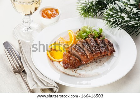 Roasted Duck Breast on New Year's festive table - stock photo