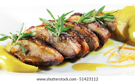 Roasted Duck Meat with Apple Slice and Sauce and Greens - stock photo