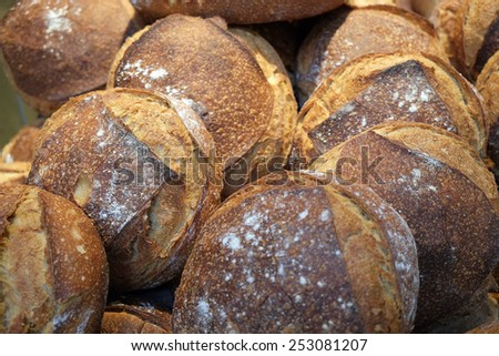 Roasted freshly baked bread on the counter, background, texture - stock photo