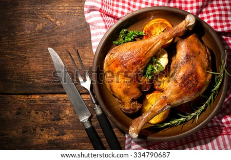 Roasted goose legs with oranges and spices. Cooking at Christmas time - stock photo