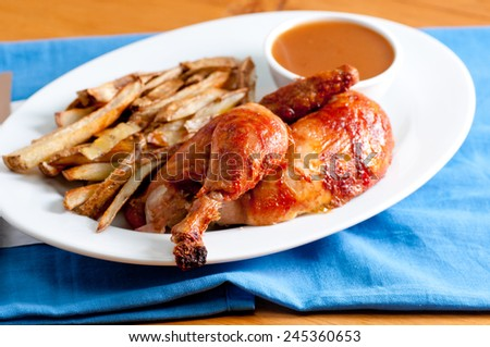 roasted half chicken dinner with french fries and gavy - stock photo