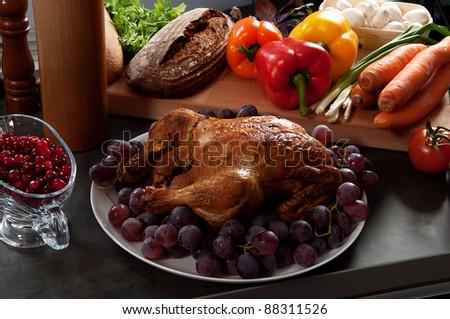 Roasted holiday turkey garnished with sourdough stuffing and fruit - stock photo