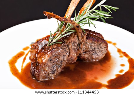 Roasted Lamb Chops on Tomato Sauce - stock photo