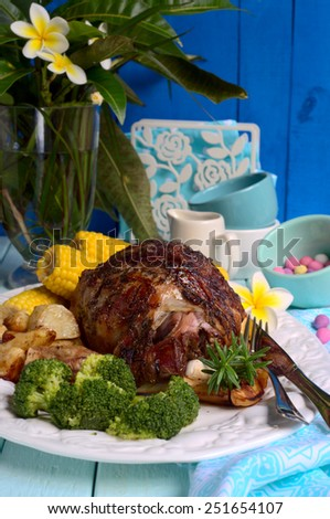 Roasted leg of lamb with herbs and vegetables for Easter dinner. selective focus - stock photo