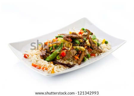 Roasted meat, white rice and vegetables - stock photo
