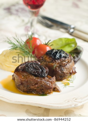 Roasted meat with mashed potatoes and glass of wine. Selective focus - stock photo