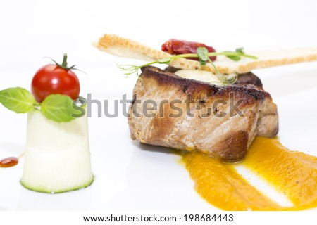 roasted meat with mustard sauce on a white background - stock photo