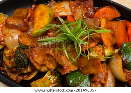 Roasted meat with vegetables in a skillet. From a series of Food Korean cuisine. - stock photo