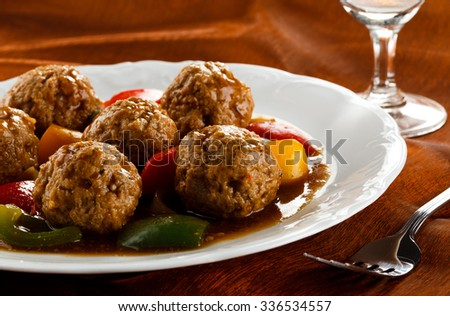 Roasted meatballs and vegetables - stock photo