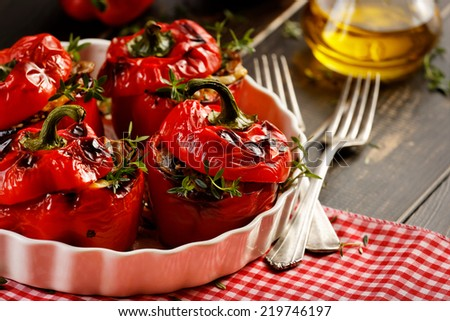 Roasted peppers stuffed with rice and mushrooms - stock photo