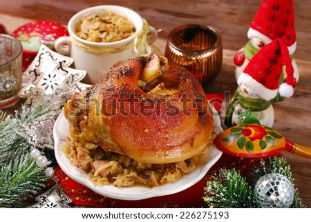 roasted pork knuckle served with bigos (sauerkraut ) for christmas dinner  - stock photo