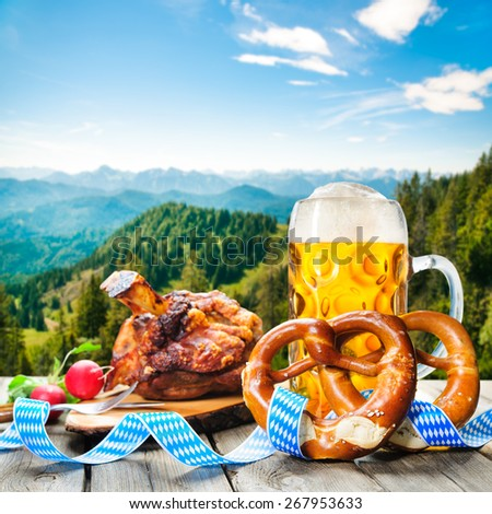 Roasted pork knuckle with pretzels and beer. Oktoberfest german festival background - stock photo