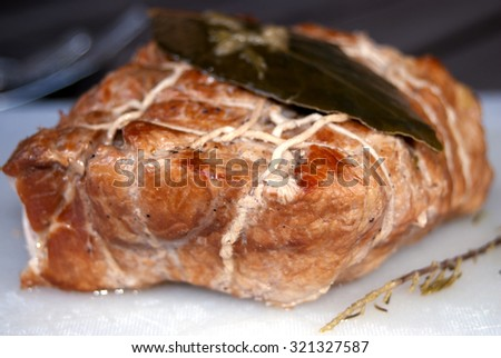 roasted pork loin cooked in oven with white wine - stock photo