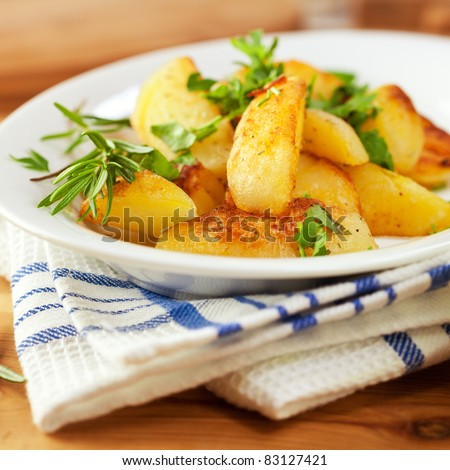Roasted potatoes with herbs - stock photo