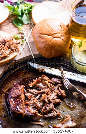 roasted pulled pork bap served with cider and apple chutney - stock photo