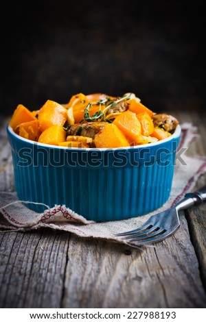 Roasted pumpkin and meat on the blue bowl? selective focus - stock photo