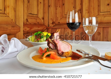 roasted rack of lamb on a plate - stock photo