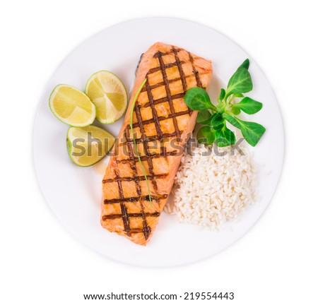 Roasted salmon fillets with rice as haute cuisine. Whole background.  - stock photo