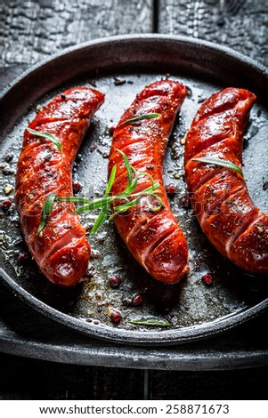 Roasted sausage with fresh herbs - stock photo