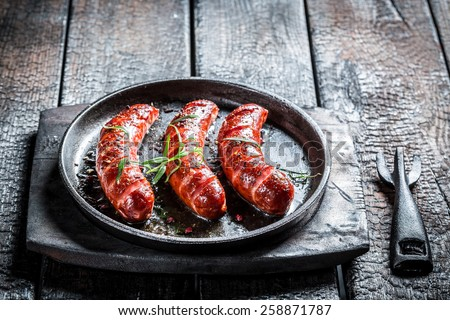 Roasted sausage with fresh rosemary - stock photo