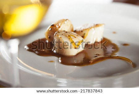 Roasted scallops with orange glaze and a hint of fennel paired with chenin blanc wine  - stock photo