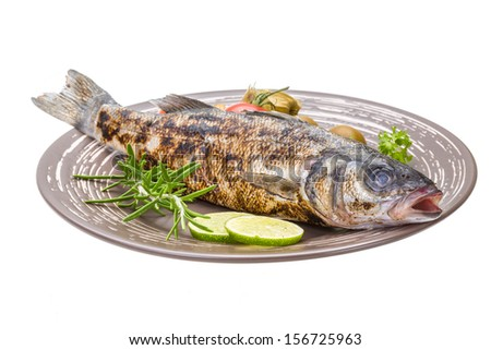 Roasted seabass with rosemary and herbs - stock photo