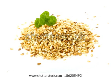 Roasted sesame seeds heap isolated  - stock photo