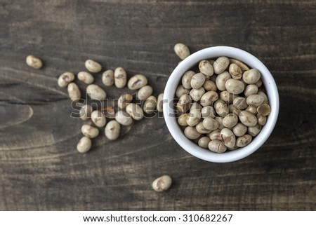 roasted soybeans in  bowl over wooden background - stock photo
