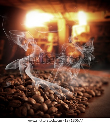 Roasted steaming coffee beans - stock photo