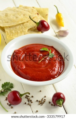 Roasted sweet pepper sauce with pita bread, dip, vertical - stock photo