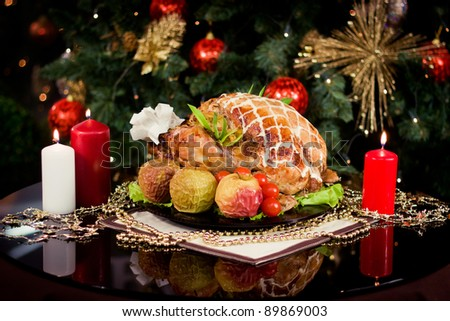 Roasted turkey and candles on a christmas new year table - stock photo