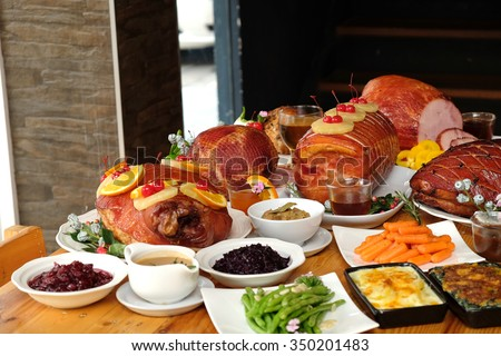 Roasted turkey and Ham for Festive dinner, Christmas dinner, Holiday table, Thanksgiving day celebration  - stock photo
