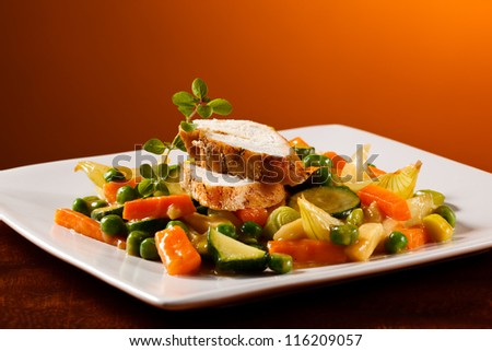 Roasted turkey fillet with vegetables - stock photo
